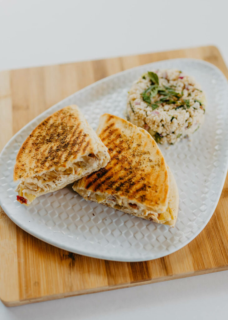Chicken & Bacon Panini - Chicken, Bacon, Onions, Artichokes With An Aeoli in Naan Bread Grilled to Perfection